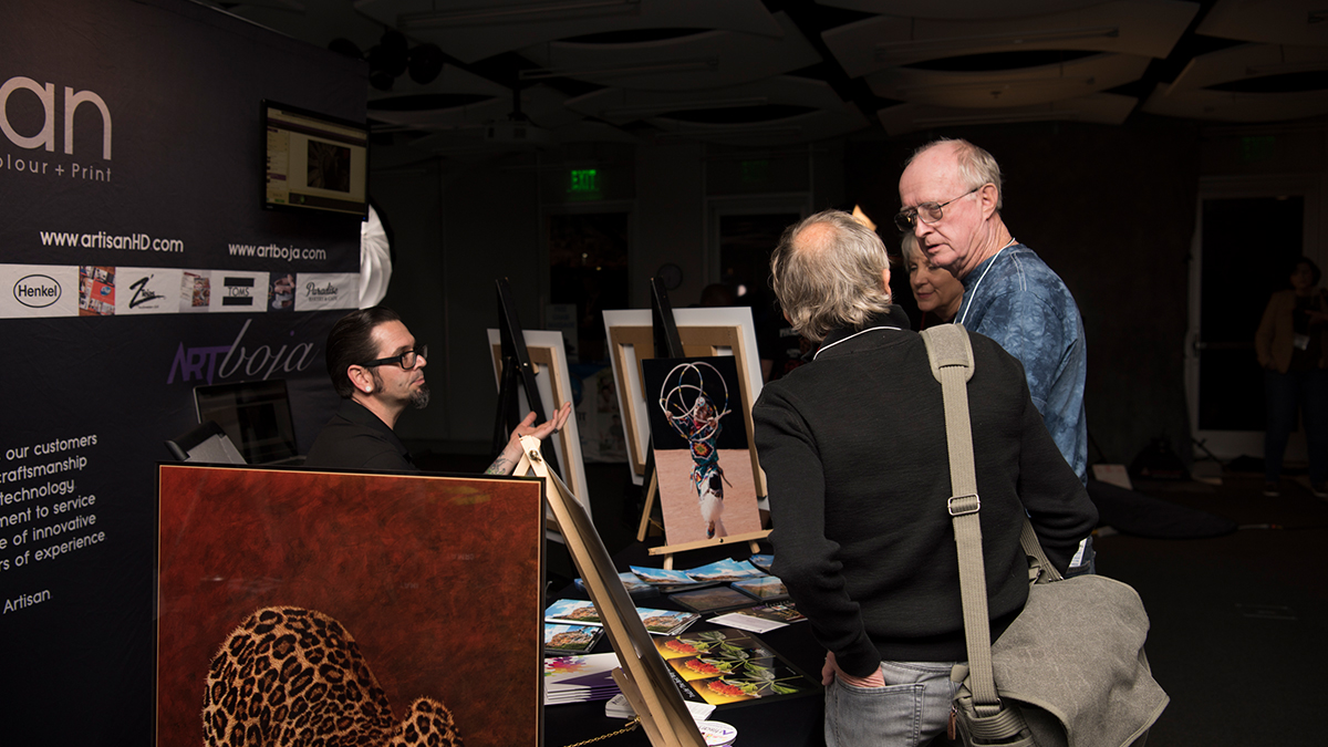 Professional Photographer AzPPA Event ArtisanHD Booth Talking To Guests