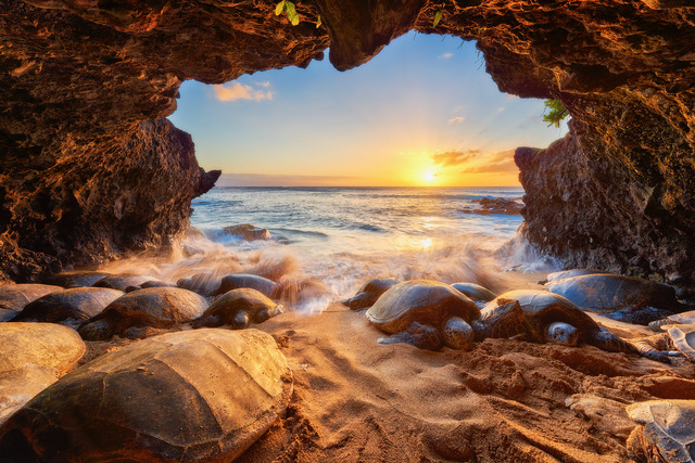 Andrew Shoemaker cavern photo looking out to ocean with sunset